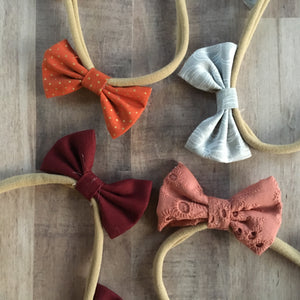 Mauve eyelet double bow headband