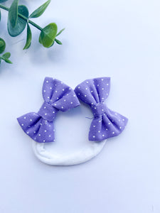 The Gunther Lavender with white polka dots double bow headband