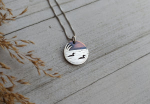 Loons on the lake - mixed metal loon wildlife pendant necklace