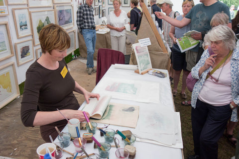 Laura Boswell doing a demo at an art fair