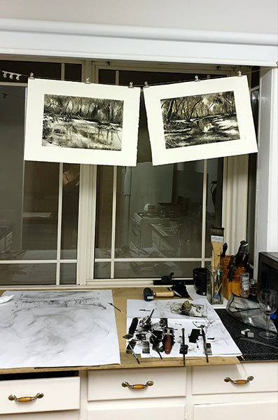 Marketa Kemp studio shot with tools and monotypes drying
