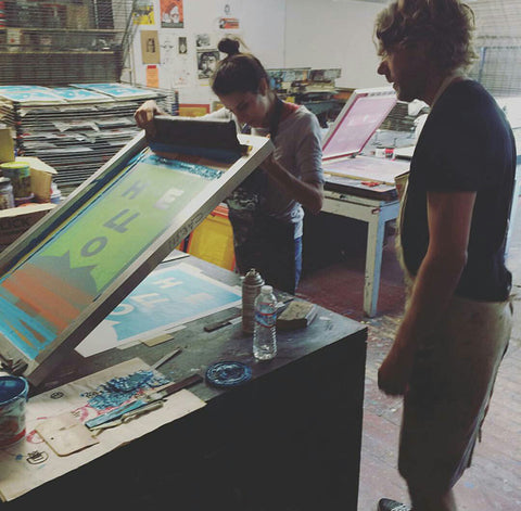 Two artists screenprinting at Mission Grafica - San Francisco