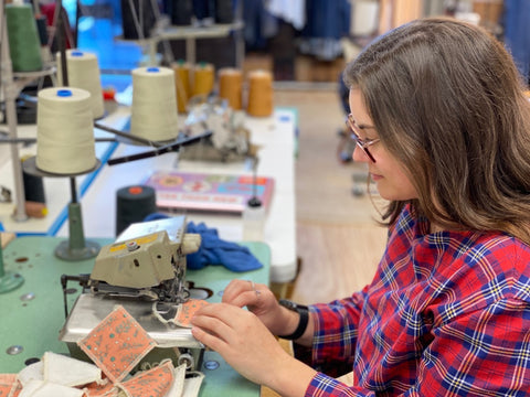 Totally Taylroed Taylor sitting at an industrial serger