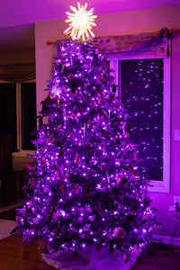 Christmas tree with purple LED lights