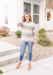 Our neutral colored stripe sweater paired with jeans.