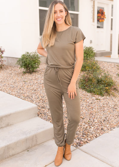 Our olive, short sleeve jumpsuit paired with booties.