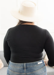 Our black, ribbed plus size bodysuit paired with jeans.