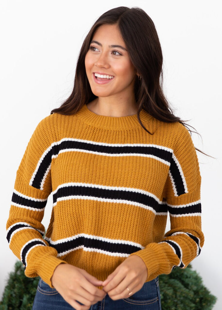 Vanessa is wearing our mustard stripe sweater creating the perfect fall look!