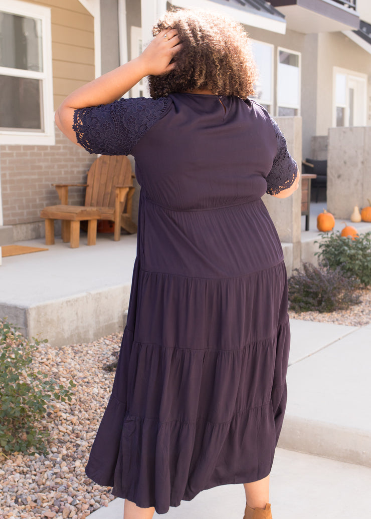 Our navy, lace sleeve, tiered plus size maxi dress.