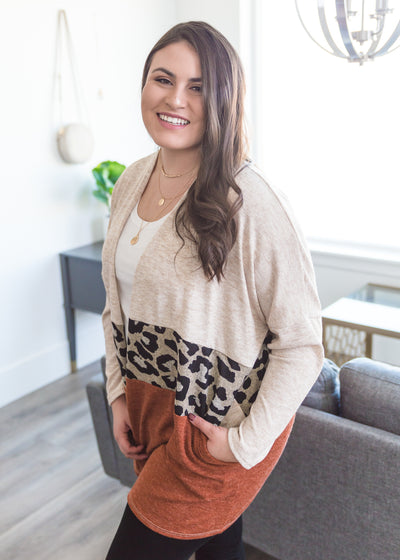 Veronica is wearing our cream, leopard and rust block cardigan paired with skinny jeans, a basic cream top and booties!
