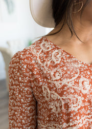 Our rust, floral embroidered blouse paired with jeans.