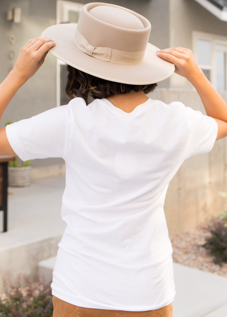 Our white 'Autumn' graphic t-shirt paired with a hat.