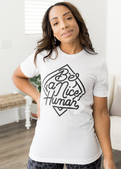 Our white and black, 'Be a nice human' graphic t-shirt paired with jeans.