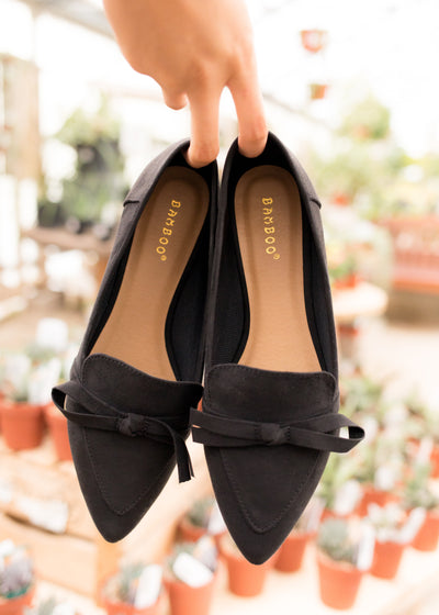 Black, bow suede flats.