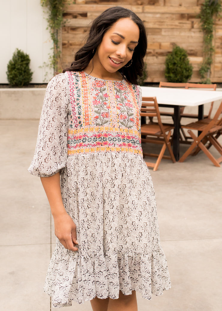 Vanessa is wearing our pattern, embroidered dress paired with platform sandals.