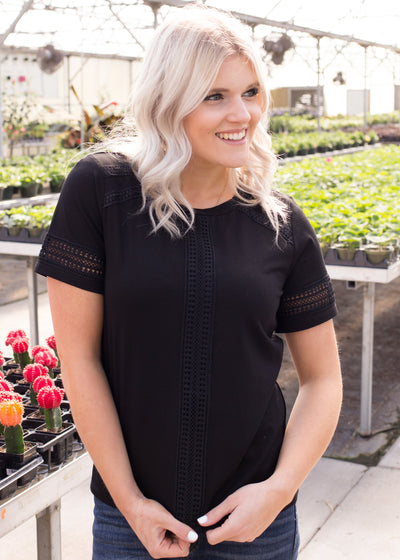 Amelia is wearing our black lace detail top paired with jeans and flats.