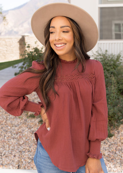 Our burgundy ruffle and lace detail blouse paired with jeans.