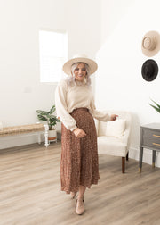 Our camel spotted midi skirt paired with a sweater.
