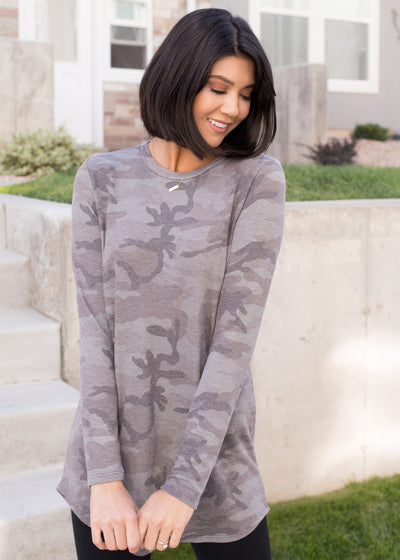 Our grey, camouflage long sleeve top paired with leggings.