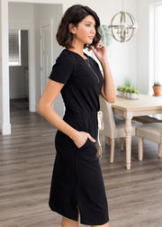 Our black, functional drawstring waist dress.