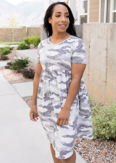 Grey, camouflage empire waist dress paired with sandals.