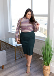 Veronica is wearing our hunter green pencil skirt paired with a stripe top and heels!