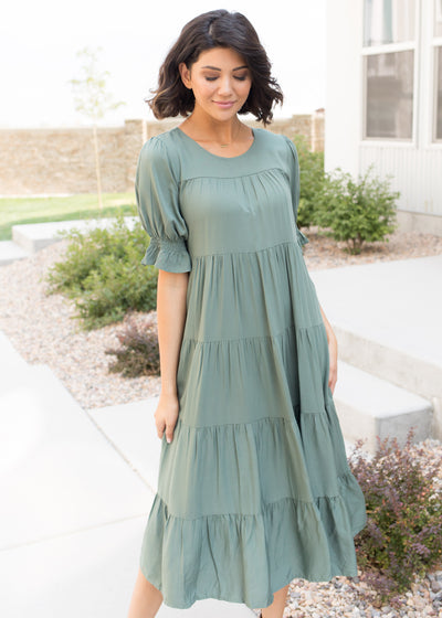 Our sage green, tiered flowy midi dress.