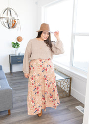 Veronica is wearing our taupe floral, tiered maxi skirt paired with a taupe sweater, booties and a hat!