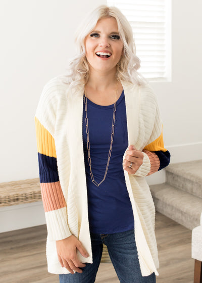 Our ivory, colorful sleeve cardigan paired with jeans.