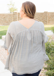 Our grey, linen style blouse paired with jeans.