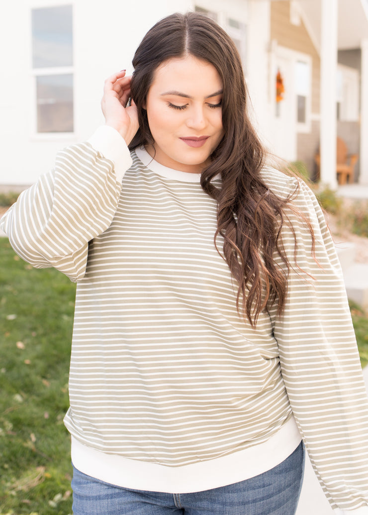 Our sage and white stripe long sleeve top paired with jeans.