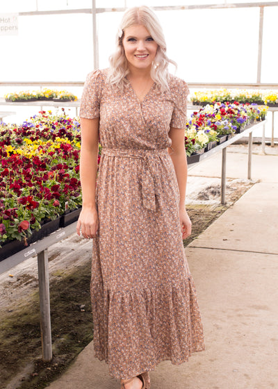 Amelia is wearing our light brown floral maxi dress paired with heels.