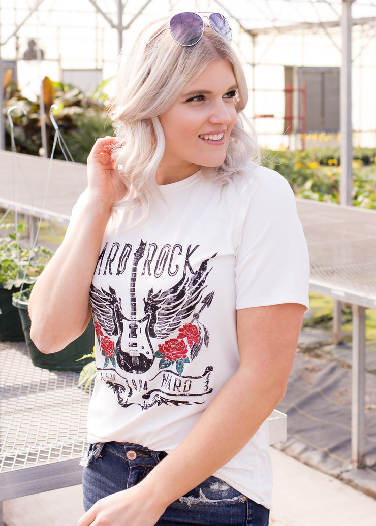 Amelia is wearing our 'hard rock' graphic t-shirt paired with jeans, and booties.