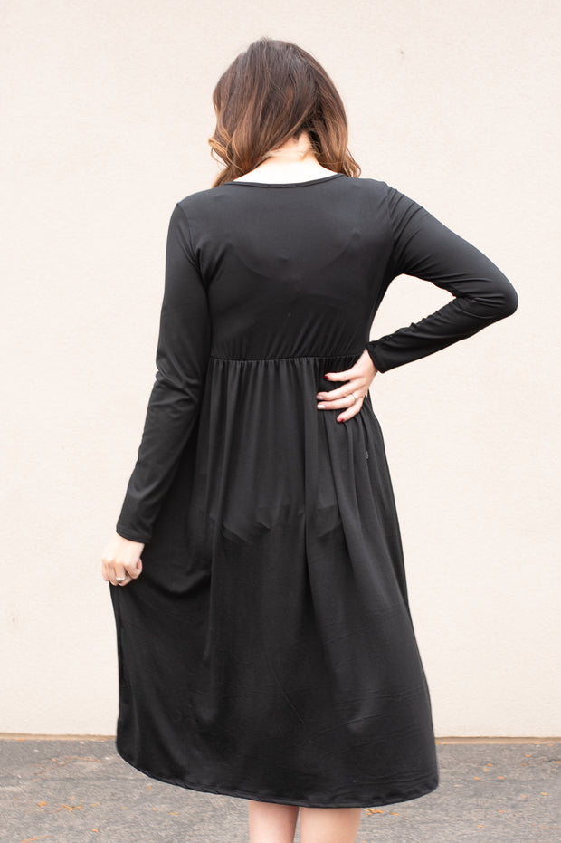 Our black, empire waist dress.