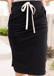 Our black, tie waist top paired with a white top.