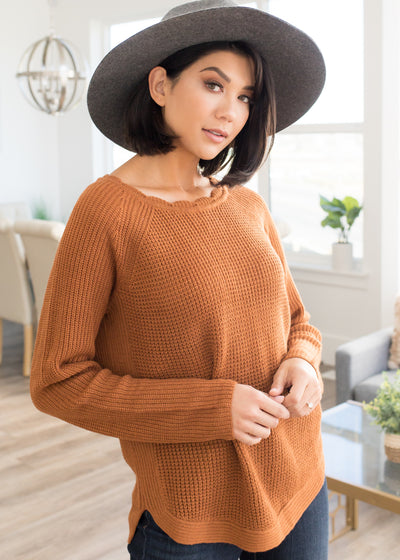Our rust, knitted sweater paired with jeans and a hat.