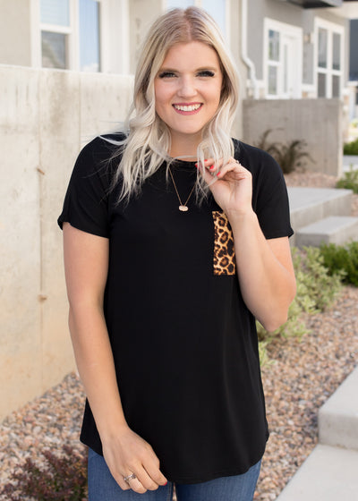 Amelia is wearing our black, leopard pocket t-shirt paired with bermuda shorts.