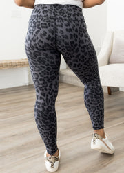 Our black leopard pattern leggings paired with sneakers.