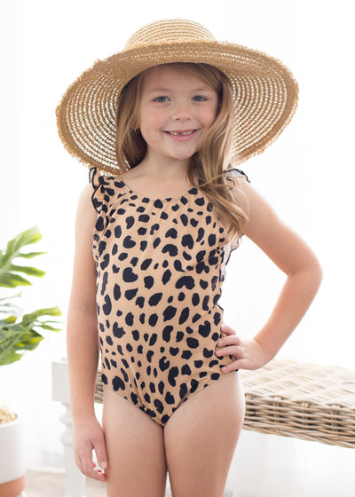 Lydia is wearing our little girls leopard print one piece swimsuit paired with a hat.