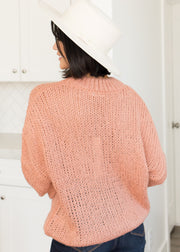 Our blush, sweater paired with jeans and a hat.