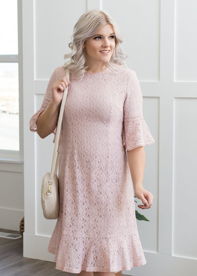 Amelia is wearing our soft pink, lace dress paired with heels!