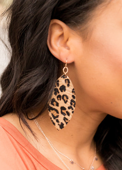 leopard print, leaf shape earrings.