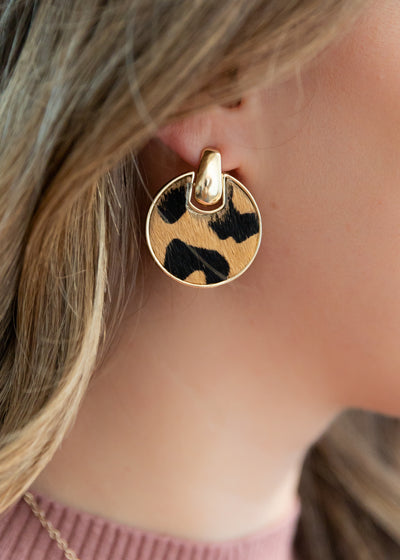 gold leopard pattern circle earrings.