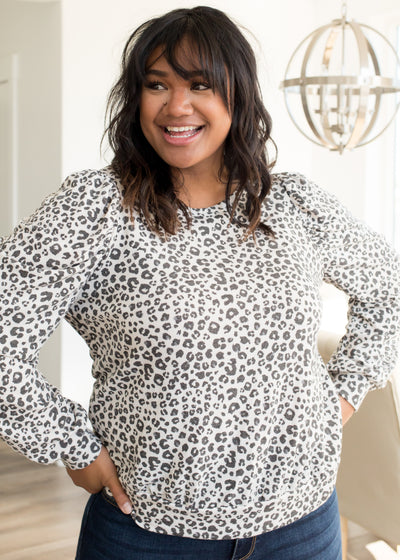 Our cream and charcoal leopard pattern plus size top paired with jeans.