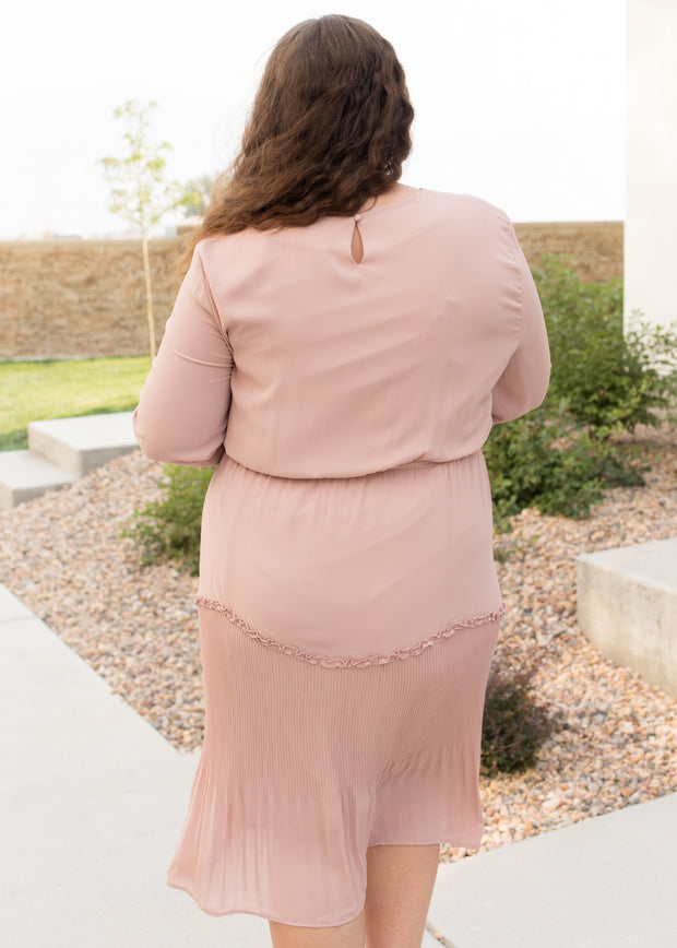 Our blush, plus size tiered detail dress paired with heels.