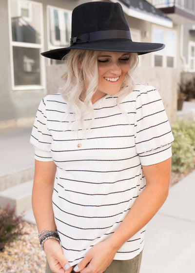Our white and black stripe puff sleeve top paired with jeans!