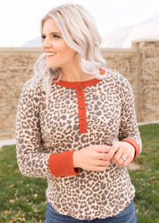 Our leopard print, rust detail top paired with jeans.