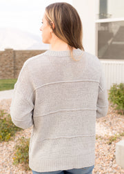 Our grey, textured stripe sweater paired with jeans.