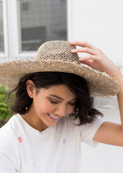 Our straw, flat brim hat.