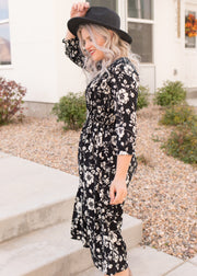 Our black and white floral pattern dress paired with a black felt hat.